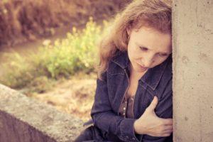 sad abused woman sitting -Dollar Photo