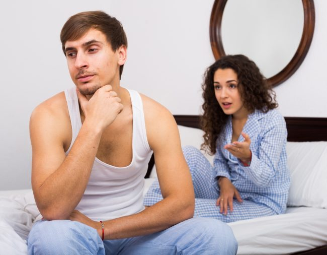 Upset husband and angry wife in bed - Adobe Stock