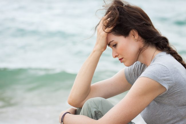 Adobe stock Sad and upset woman deep in thought