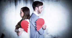 Dollar Photo Composite image of side view of couple holding broken heart
