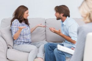 Stability in marriage Dollar Photo - Couple going through therapy and crying on the couch as therapist listens