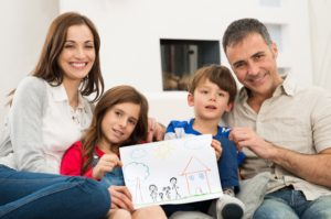 Mission Dollar Photo Family with new house drawing