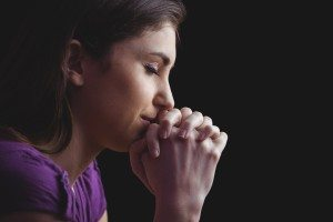 Dollar Photo Woman praying with hands together