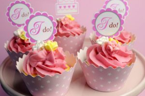Dollar Photo Pink wedding cupcakes with I Do topper signs