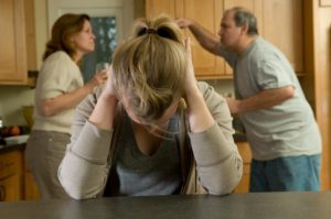 Arguing Photoclub Teen daughter agonizes while parents fight