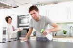 Young Couple Cleaning Cleaning Kitchen -Dollarphotoclub_23438396.jpg