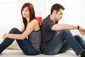 Dollar Photo Young couple sittin back to back on the sofa,having relationship