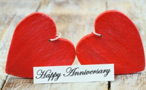 Dollar Photo Happy Anniversary card with two red wooden hearts