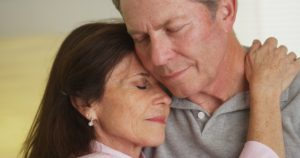 Dollar Photo Loving elderly couple holding each other