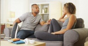 Dollar Photo Black couple having a conversation in their living room