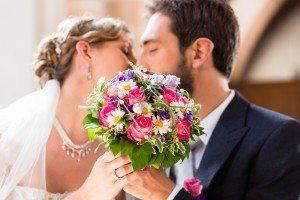 Growing love - Dollar Photo Bridal couple giving kiss in church at wedding
