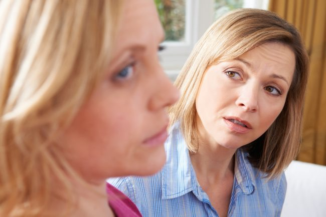 Adobe Stock Unhappy Woman In Conversation With Friend Or Counselor