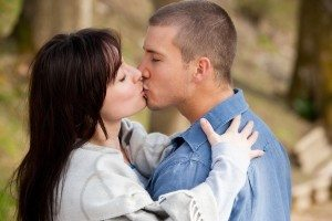 Dollar Photo Attractive young couple kissing outdoors