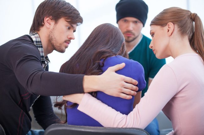 friends sympathizing and comforting a friend Adobe Stock