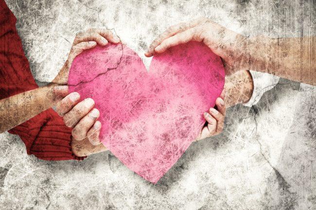 couple holding a heart - Adversity
